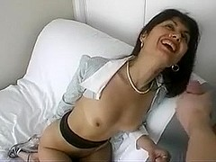Elegant brunette with sexy bare boobs gets facialized