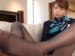 Sexy japanese gives foot job on couch