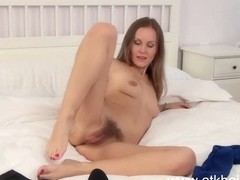 Lera masturbates on a white bed