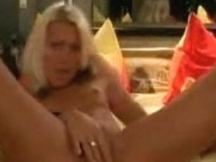 Amazing blonde masturbating and stuffing huge dildos in hes pussy