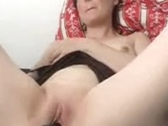 Mature wife being toyed with a huge dildo on camera