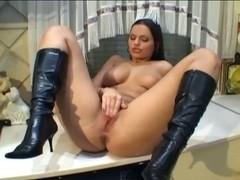 Breasty Sweetheart With Leather Boots In The Kitchen