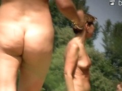 Beach nudist asses sexily waved under the blue sky