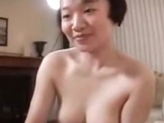 Asian babe gives a stunning blowjob