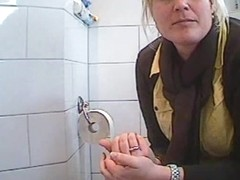 Woman being caught on hidden camera in bathroom