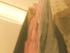 Girl in changing room admires her own reflection in mirror