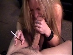 Concupiscent golden-haired massages the tip of a thick penis with her lips