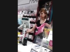 Horny looking redhead shop assistant