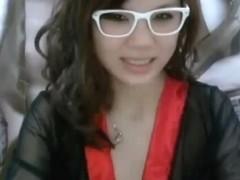 Lovely Oriental chick pulls a nice masturbation show on web cam