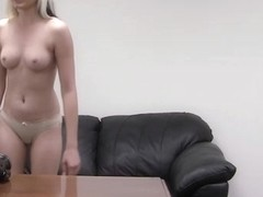 Young blonde smiling as she gets a load of cum on her face