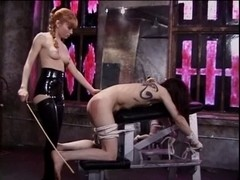 Misstress Lolita thrashing her slaves butt