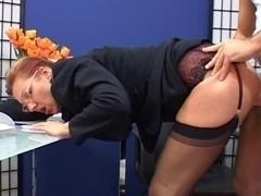 Stylish older secretary drilled