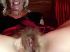 Webcam solo with a granny demonstrating her extremely hairy cunt