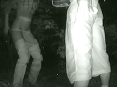 Candid night video of a skinny girl peeing in the bushes