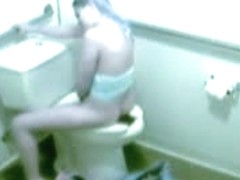 Voyeur masturbation video with long haired gal cumming in toilet