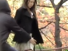 Lovely Japanese girl has her skirt lifted in public