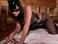 The cat woman Henessy plays with her cleft