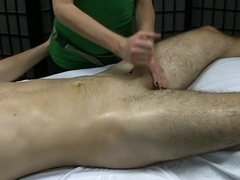 Kinky girl gives a handjob during a massage