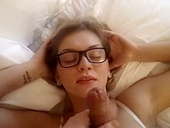 Babe with glasses acquires a filthy facial