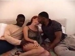 Mature redhead gets shared by black dudes in bedroom action