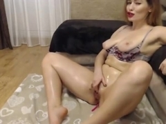 Sexy blonde milf plays with her pussy