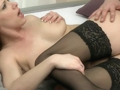 Curly blonde MILF in hot oral action