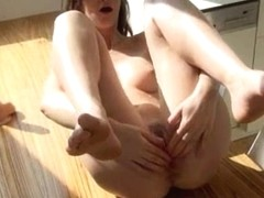 Hard pussy toying on the table