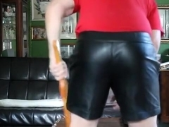 Paddled in Priape leather shorts