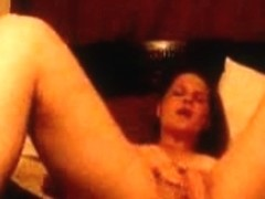 Sexy housewife with natural boobs masturbates her beaver