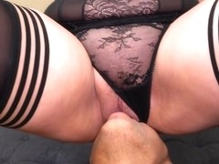 Experienced, mature blonde in erotic lingerie is sucking dick and getting fucked on the sofa