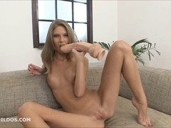 Slim golden-haired stretching her wet crack with a large sextoy
