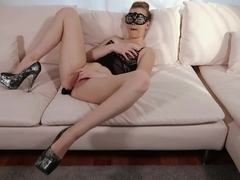 Masquerade on a sofa with my red vibrator inside my pussy