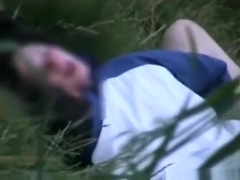 Voyeur tapes a brunette getting missionary fucked in nature