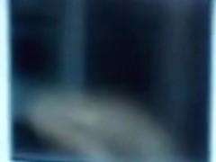 Nude titted female is seen on window voyeur video