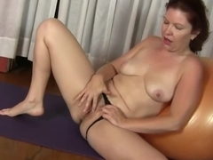 Kimberlee Cline is doing her yoga routine and rubbing her pussy to spice it up