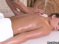 Masseur rubs oil to sexy body of brunette
