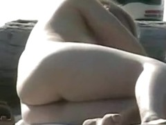Nude sunbathing girls are shot with a hidden camera