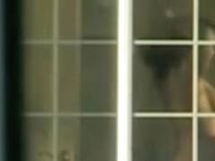 Brunette from the opposite window gets fully naked