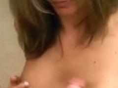 Breasty chick rubs her milk sacks on his jock