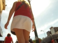 Upskirting sexy babe at the train platform in sexy white skirt