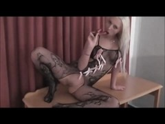 Delightful German blonde in bodystocking plays, sucks, fucks