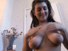 Horny MILF demonstrates her wonderful melons in the room