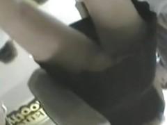 Coquette's legs caught in the mall on voyeur cam