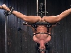 Slut in upside down bondage toyed