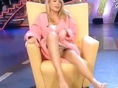A sexy blonde woman shows off her feet in a TV show