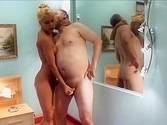 Milf in panties does european handjob to fat guy