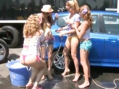 Four Horny Lesbians Have Some Naughty Fun At A Car Wash