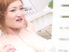 Busty asian by the pool with natural breasts