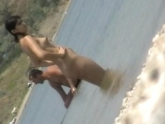 Impudent girl shows her naked body at the public beach
