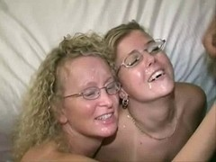 two Golden-Haired Milfs in Swinger Club